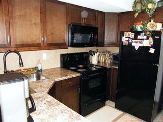 Photo 4: 1436 22 Avenue: Didsbury Row/Townhouse for sale : MLS®# C4271771