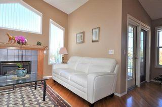 Photo 5: 169 ROCKY RIDGE Cove NW in Calgary: Rocky Ridge House for sale : MLS®# C4140568