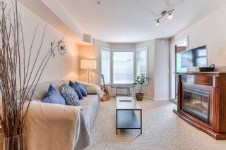 """Photo 1: 344 5660 201A Street in Langley: Langley City Condo for sale in """"Paddington Station"""" : MLS®# R2264682"""