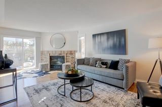 Photo 1: 212 Coachway Lane SW in Calgary: Coach Hill Row/Townhouse for sale : MLS®# A1153091
