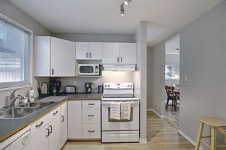 Photo 15: 787 Kingsmere Crescent SW in Calgary: Kingsland Row/Townhouse for sale : MLS®# A1108605
