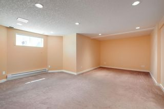 Photo 17: 3118 39 Street SW in Calgary: Glenbrook Detached for sale : MLS®# A1105435