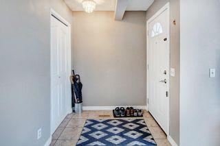 Photo 2: 29 FALBURY Crescent NE in Calgary: Falconridge Semi Detached for sale : MLS®# C4288390