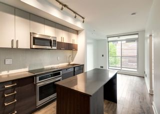 Photo 4: 409 550 Riverfront Avenue SE in Calgary: Downtown East Village Apartment for sale : MLS®# A1139717