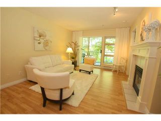 """Photo 1: 210A 301 MAUDE Road in Port Moody: North Shore Pt Moody Condo for sale in """"HERITAGE GRAND"""" : MLS®# V1083128"""