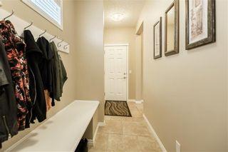 Photo 5: 325 BRIDLERIDGE View SW in Calgary: Bridlewood House for sale : MLS®# C4177139