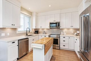 """Photo 1: 9 5945 177B Street in Surrey: Cloverdale BC Townhouse for sale in """"THE CLOVER"""" (Cloverdale)  : MLS®# R2624605"""