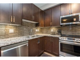 """Photo 3: 210 6490 194 Street in Surrey: Clayton Condo for sale in """"WATERSTONE ESPLANADE GRANDE"""" (Cloverdale)  : MLS®# R2603405"""