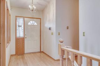 Photo 2: 52 WOODMEADOW Close SW in Calgary: Woodlands Semi Detached for sale : MLS®# C4259772