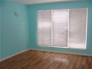 Photo 3: 30 ERIN RIDGE Place SE in CALGARY: Erinwoods Residential Detached Single Family for sale (Calgary)  : MLS®# C3602698