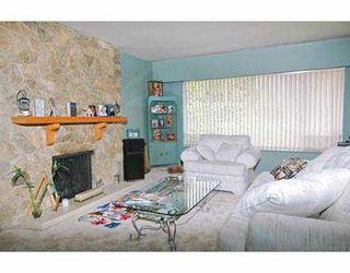 Photo 5: 1402 COMO LAKE AV in Coquitlam: Central Coquitlam House for sale : MLS®# V536066