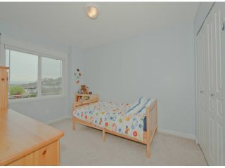 """Photo 11: 5767 148A Street in Surrey: Sullivan Station House for sale in """"Sawyers Walk at Panorama Village"""" : MLS®# F1310562"""