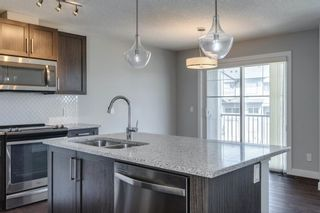 Photo 12: 527 Sage Hill Grove NW in Calgary: Sage Hill Row/Townhouse for sale : MLS®# A1082825