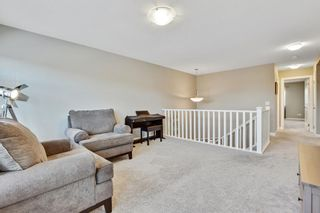 Photo 21: 207 Kinniburgh Road: Chestermere Semi Detached for sale : MLS®# A1057912