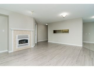"Photo 8: 203 15466 NORTH BLUFF Road: White Rock Condo for sale in ""THE SUMMIT"" (South Surrey White Rock)  : MLS®# R2371084"