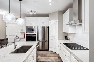 Photo 5: 310 200 Auburn Meadows Common SE in Calgary: Auburn Bay Apartment for sale : MLS®# A1153208