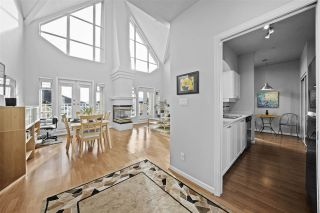 """Photo 1: 519 3600 WINDCREST Drive in North Vancouver: Roche Point Condo for sale in """"Raven Woods"""" : MLS®# R2530958"""