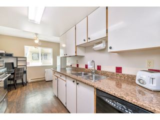 """Photo 7: 103 7349 140 Street in Surrey: East Newton Townhouse for sale in """"Newton Park"""" : MLS®# R2464654"""
