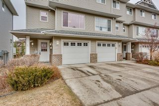 Photo 2: 20 CRYSTAL SHORES Cove: Okotoks Row/Townhouse for sale : MLS®# C4238313