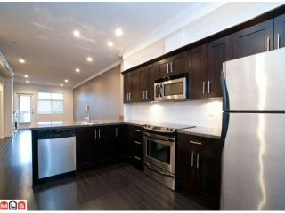"""Photo 5: 14 15192 62A Avenue in Surrey: Sullivan Station Townhouse for sale in """"ST. JAMES GATE"""" : MLS®# F1104157"""