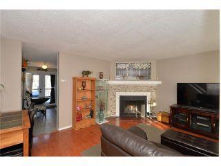 Photo 3: 10 GLENPATRICK Crescent: Cochrane House for sale : MLS®# C4094257