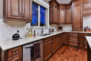 Photo 15: 72 ROCKCLIFF Grove NW in Calgary: Rocky Ridge Detached for sale : MLS®# A1085036