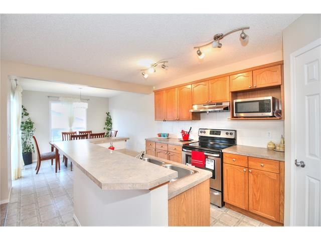 Photo 13: Photos: 606 EVERMEADOW Road SW in Calgary: Evergreen House for sale : MLS®# C4053479