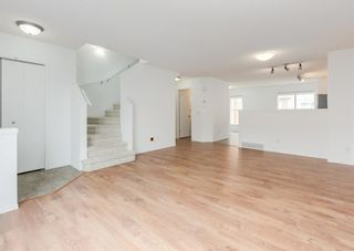 Photo 5: 311 Toscana Gardens NW in Calgary: Tuscany Row/Townhouse for sale : MLS®# A1133126