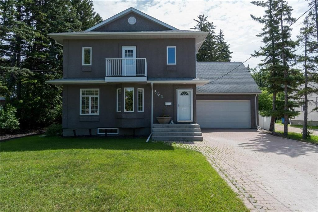 Welcome to 561 Community! Talk about curb appeal. This stunning 2,400+ sqft home in the heart of Charleswood has so much to offer. That attached garage is HUGE! It can fit 4-5 cars, is insulated and has in-floor heat! Watch our video to get the full exper