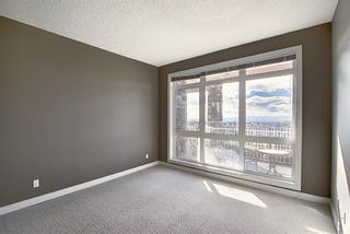 Photo 7: 4 145 Rockyledge View NW in Calgary: Rocky Ridge Apartment for sale : MLS®# A1041175