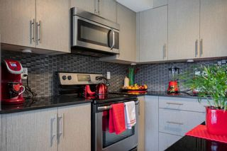 Photo 7: 15 West Coach Manor SW in Calgary: West Springs Row/Townhouse for sale : MLS®# A1100327