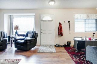Photo 2: 9 209 Woodside Drive NW: Airdrie Row/Townhouse for sale : MLS®# A1106709