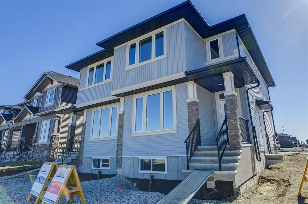 Main Photo: 136 Creekside Drive SW in Calgary: C-168 Semi Detached for sale : MLS®# A1108851