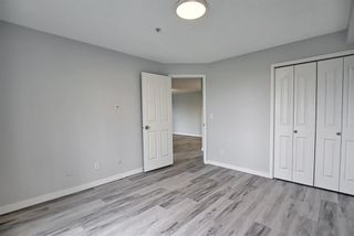 Photo 24: 7312 304 Mackenzie Way: Airdrie Apartment for sale : MLS®# A1118474