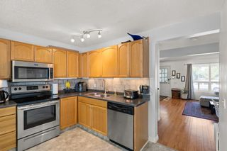 Photo 8: 14 Queen Anne Close SE in Calgary: Queensland Row/Townhouse for sale : MLS®# A1146388