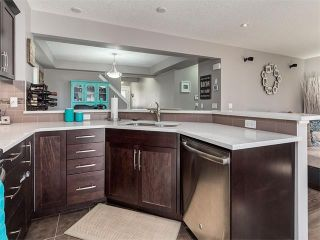 Photo 5: 18 WINDWOOD Grove SW: Airdrie House for sale : MLS®# C4082940