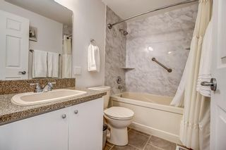 Photo 18: 14 5625 Silverdale Drive NW in Calgary: Silver Springs Row/Townhouse for sale : MLS®# A1153213