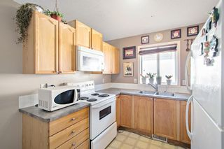 Photo 3: 1058 Bridlemeadows Manor SW in Calgary: Bridlewood Detached for sale : MLS®# A1084689