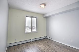 Photo 28: 7402 304 MacKenzie Way SW: Airdrie Apartment for sale : MLS®# A1081028
