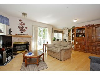 """Photo 7: 105 20240 54A Avenue in Langley: Langley City Condo for sale in """"Arbutus Court"""" : MLS®# F1315776"""