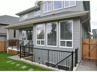 """Photo 19: 16951 79TH Avenue in Surrey: Fleetwood Tynehead House for sale in """"THE LINKS"""" : MLS®# F1412362"""