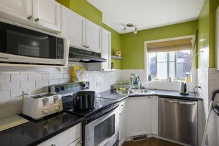 Photo 2: 102 140 Sagewood Boulevard SW: Airdrie Row/Townhouse for sale : MLS®# A1141135