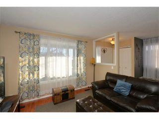 Photo 7: 10 GLENPATRICK Crescent: Cochrane House for sale : MLS®# C4094257