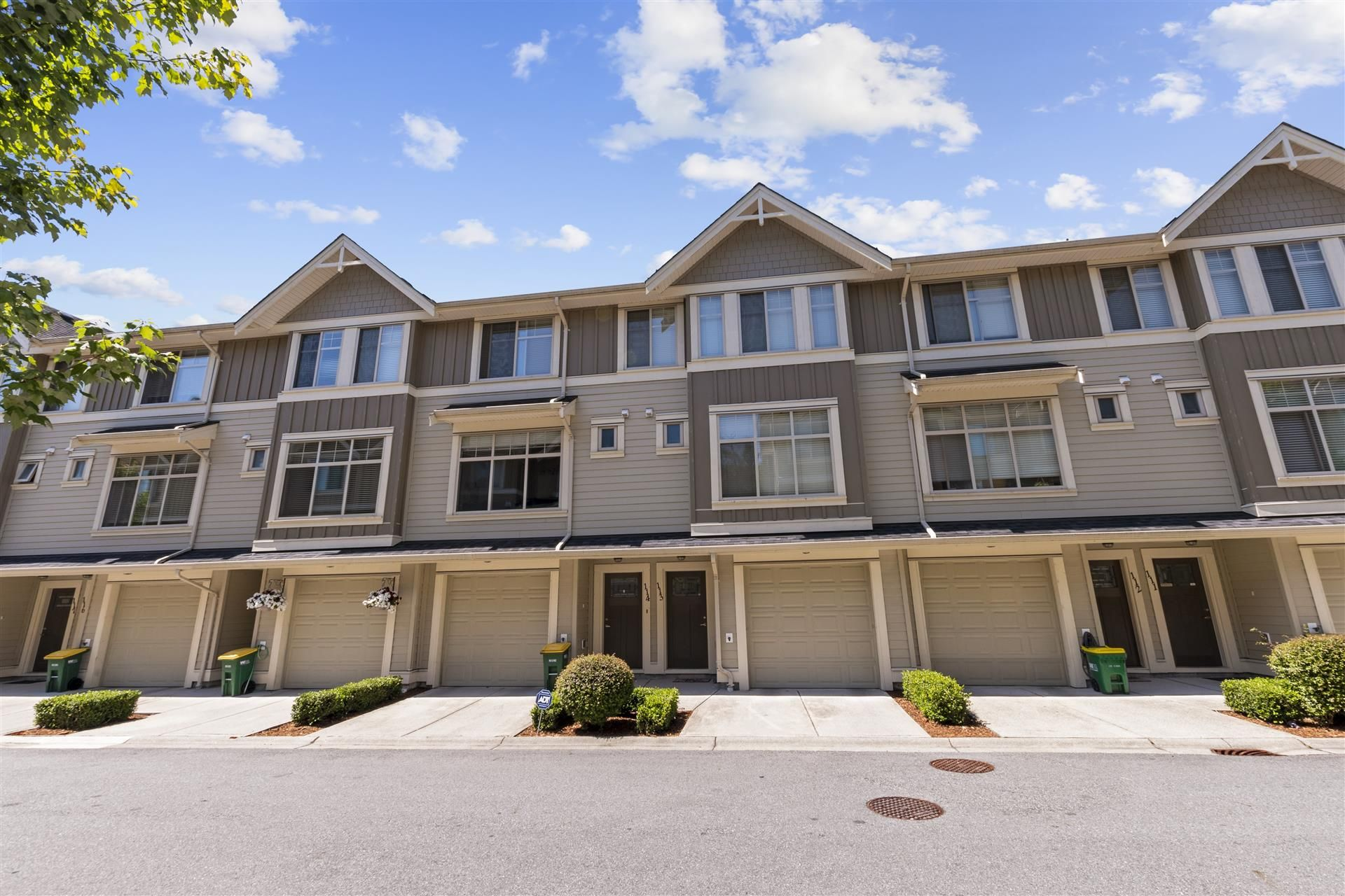 Main Photo: 114-19525 73rd Ave in Surrey: Clayton Townhouse for sale : MLS®# R2477208