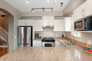"""Photo 1: 4 2978 WHISPER Way in Coquitlam: Westwood Plateau Townhouse for sale in """"WHISPER RIDGE"""" : MLS®# R2300463"""