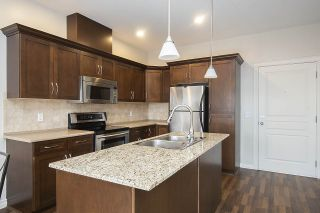 """Photo 4: #209 2655 MARY HILL Road in Port Coquitlam: Central Pt Coquitlam Condo for sale in """"Falcon Court"""" : MLS®# R2557522"""