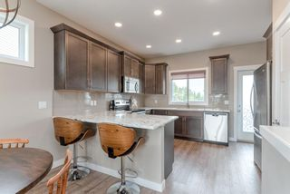 Photo 11: 633 Country Meadows Close: Turner Valley Detached for sale : MLS®# A1130452