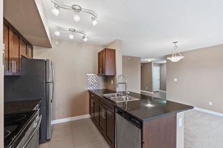 Photo 8: 7411 403 Mackenzie Way SW: Airdrie Apartment for sale : MLS®# A1152134