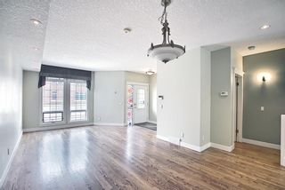 Photo 4: 1715 College Lane SW in Calgary: Lower Mount Royal Row/Townhouse for sale : MLS®# A1134459
