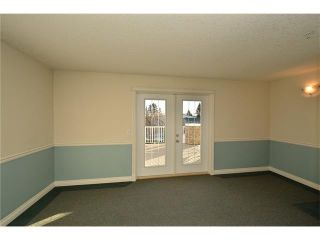 Photo 32: 208 128 CENTRE Avenue: Cochrane Condo for sale : MLS®# C4048864